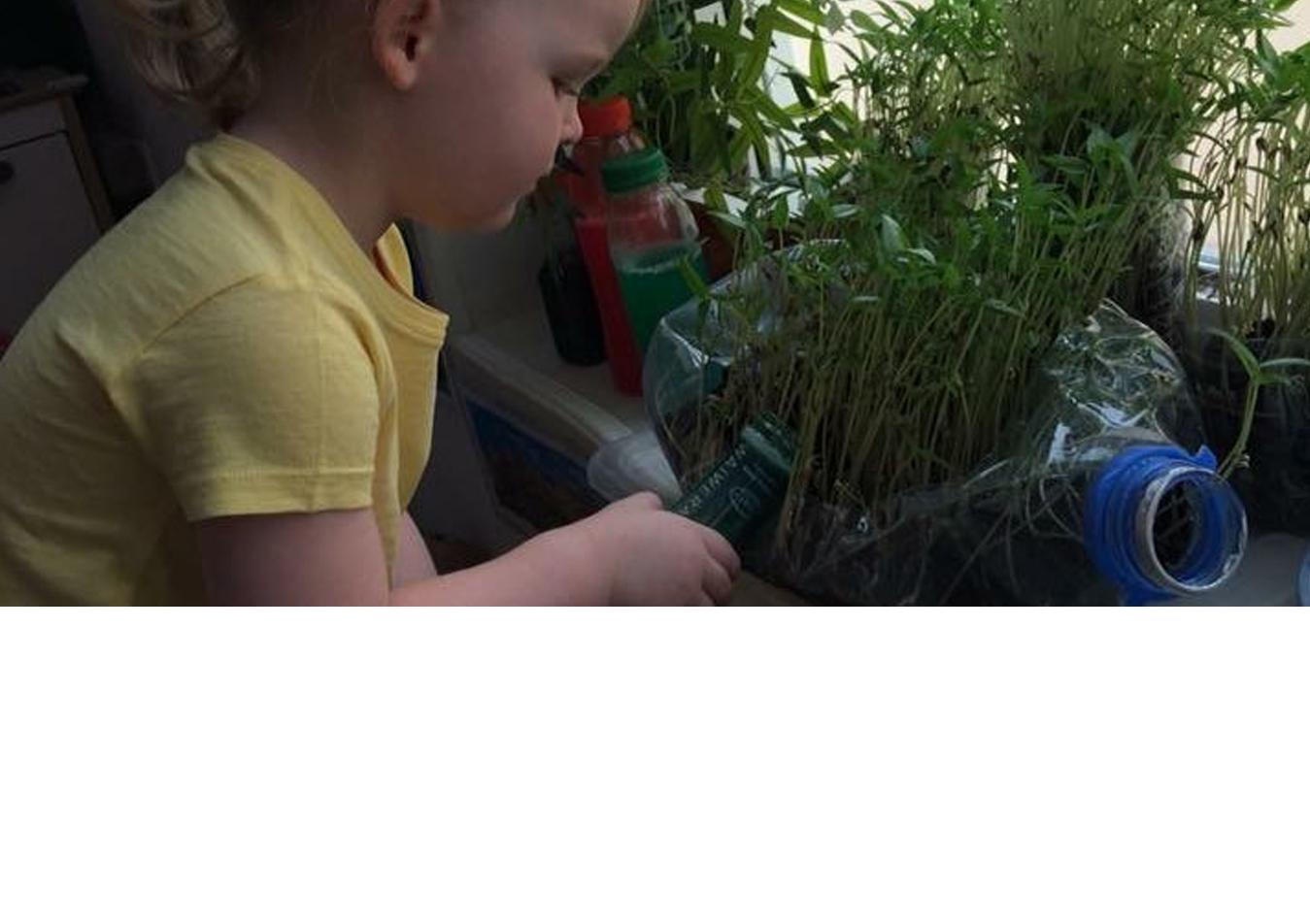 ella watering plants for web site-slide v2